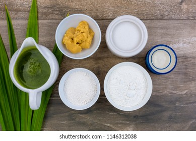 """""""Khanom thuai, or khanom thuai talai"""" is a Thai dessert made from rice flour, coconut milk,palm sugar,pandan leaves water(optional). Its name is derived from the small ceramic cups."""