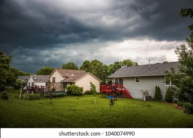 Thuderstorm clouds over suburban houses
