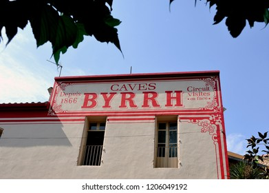 THUIR, FRANCE - SEPTEMBER 5, 2018: Old advertisement on the old frontage of the Byrrh company in Thuir making the famous world-famous aperitif