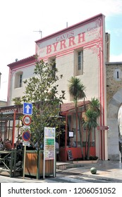 THUIR, FRANCE - SEPTEMBER 5, 2018: Old entrance facade of the Byrrh factory in Thuir where is today a bistro