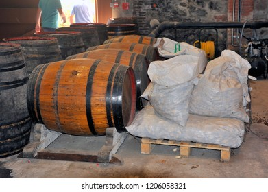 THUIR, FRANCE - SEPTEMBER 5, 2018: Oak barrels and interior of a wine cellar