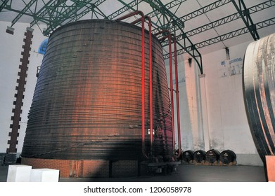 THUIR, FRANCE - SEPTEMBER 5, 2018: The largest oak vat in the world containing one million two hundred liters of wine in the cellars of the Byrrh company in Thuir