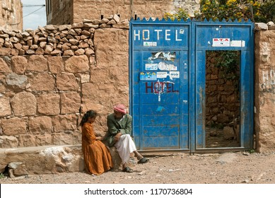 Thula, Yemen - May 5, 2007: A man in traditional clothes talks to his daughter outside a hotel. Although infant mortality is high, children in Yemen are culturally, socially and religiously valued.