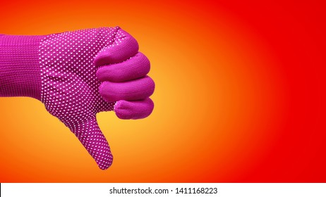 Thumb Down Hand Gesture in Glove Isolated on Red Orange Background