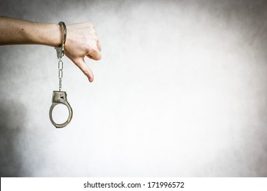 Thumb down with shackles