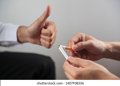 Thumb up for encourage or cheer up people that decide to quit smoking on world tobacco day.