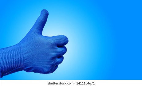 Thumb Up Hand Gesture in Glove Isolated on Blue Background
