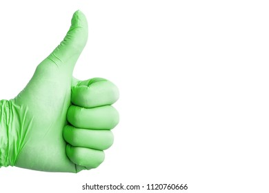 Thumb up sign. Hand in green latex glove isolated on white.