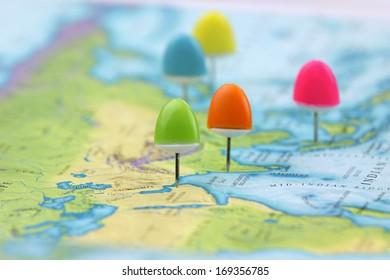 Thumb tacks on Asia map