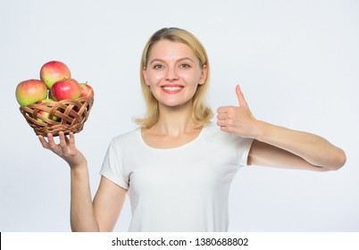 thumb up. vitamin and dieting food. farming concept. healthy teeth. orchard, gardener girl with apple basket. Happy woman eating apple. autumn harvest. Spring seasonal fruit. Full of vitamins.