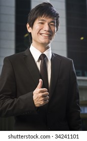 thumbs up from an asian businessman