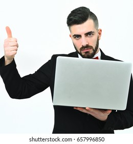 Thumbs up for bearded macho businessman with white open laptop, isolated on white background, copy space. Concept of perfect business and finished work