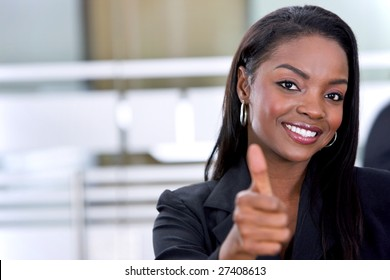 Thumbs up black business woman at the office