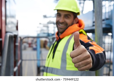 Thumbs up docker smiling to camera