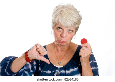 Thumbs down for a mature gray haired woman with her last red poker chip.