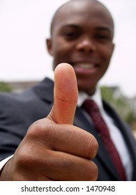 thumbs up (focus on thumb)