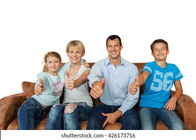Thumbs up - happy family on a couch isolated on white