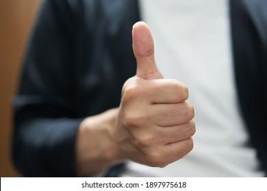 Thumbs up man's hand photo