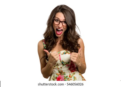 Thumbs up from quirky spirited fun goofy woman in glasses celebrating joy happiness