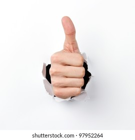 Thumbs up through the hole in paper sheet