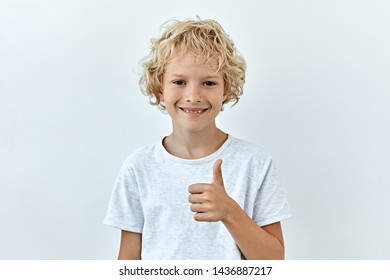 Thumbs up. Portrait of  who a showing agree and approval sing.
