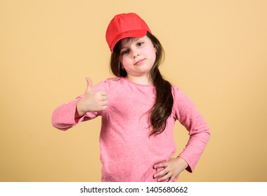 Thumbs up if you feel beautiful. Adorable girl showing approval hand gesture. Cute small child gesturing approval sign. Little kid expressing approval for clothing and accessory. Seal of approval.