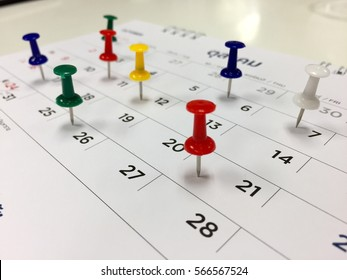 Thumbtack in calendar concept for busy, appointment and meeting reminder.