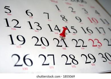 thumbtack marking a date