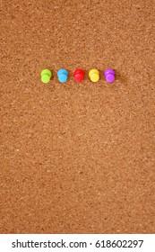 Thumbtack nailed to a corkboard