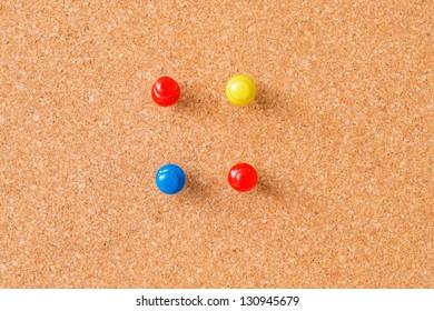 Thumbtacks on cork board