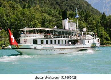 """THUN. SWITZERLAND - CIRCA JULY 2016:The steamboat """"Bluemlisalp"""" cruising on lake Thun, Switzerland"""