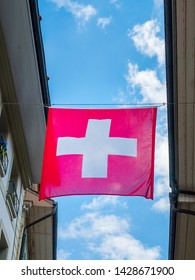 Thun, Switzerland - May 30th 2019: Swiss flag is using as decoration at Townhall square or Rathausplatz which is the center of Thun city, Switzerland