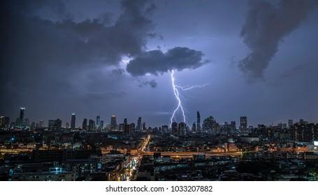 The thunder storm with Bangkok city life background