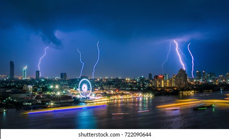 Thunder storm lightning strike on the dark cloudy sky over business building area in Bangkok,Thailand. Bangkok is the capital of Thailand and also the most populated city.