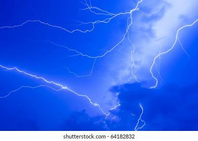 Thunder storm and power Lightning over sky .