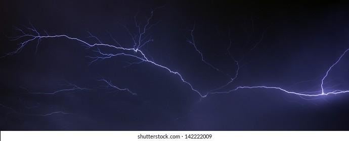 Thunderbolt of lightning spreading on the sky at night
