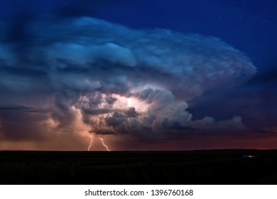 Thunderstorm with lightning and cumulonimbus storm clouds