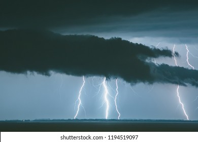 Thunderstorm near the city of Trieste, Italy , lightning beats the water