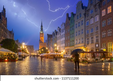 Thunderstorm in old town of Gdansk at night, Poland