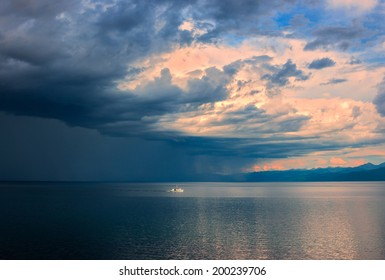Thunderstorm on of South part lake Baikal evening in July