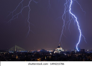Thunderstorm over the city. Lighting over the city church. bad weather concept.