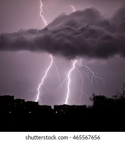Thunderstorm over the city in summer night