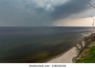 Thunderstorm over the green sea water