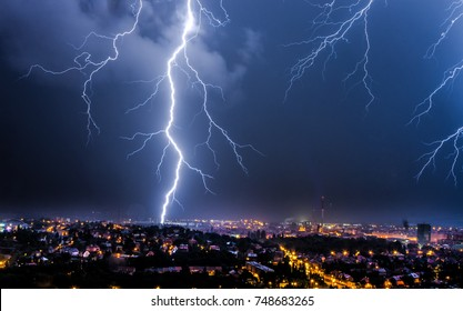 Thunderstorms and lightning over the night city.