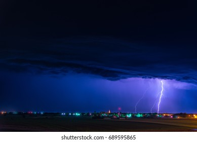 Thunderstruck and lightning over city on blue sky