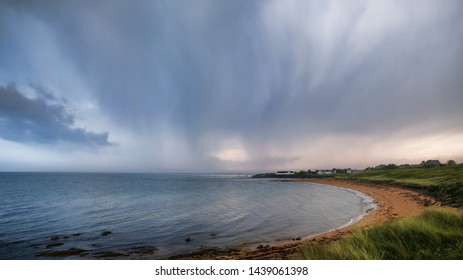 Thundery skies over Brora beach in Sutherland in the Highlands of Scotland
