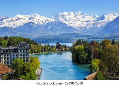 Thuner lake viewed from Thun city with beautiful panorama view to Alps snow mountain scenery - Switzerland