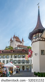 THUN,SWITZERLAND - SEPTEMBER 3,2016 - Castle Thun above market place of Thun town. Thun is a town and a municipality in the administrative district of Thun in the canton of Bern in Switzerland.