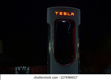 Thuringia, Germany - Jan. 03, 2019: Tesla Supercharger near highway in thuringia at night