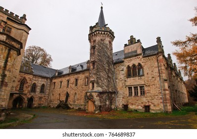"""THURINGIA, GERMANY - NOV 05,2016: Abandoned castle """"Schloss Rapunzel"""", located in Thuringia a few hundred kilometers from Berlin. Beautiful neo-gothic palace. Clock tower."""